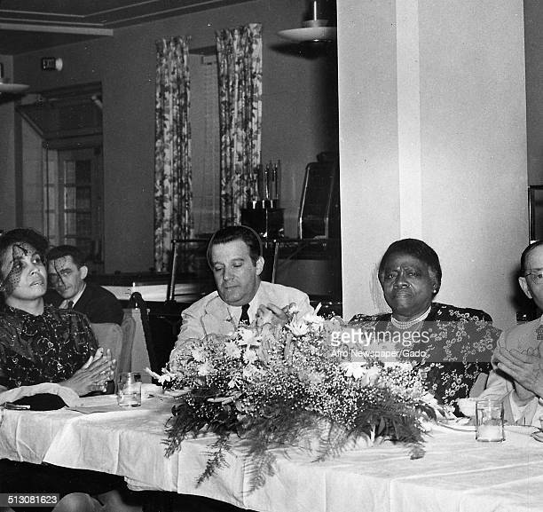 Educator and Civil Rights activist Mary McLeod Bethune sitting at a banquet table 1945