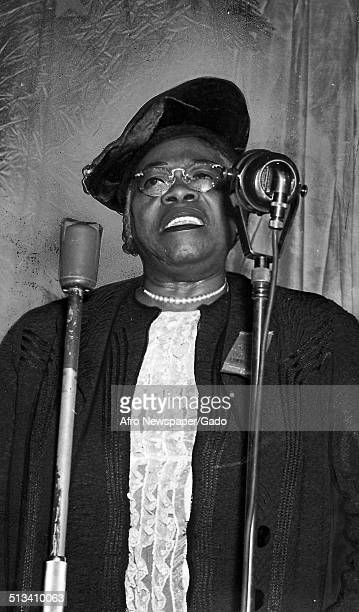 Educator and Civil Rights activist Mary McLeod Bethune speaking into a microphone February 19 1943