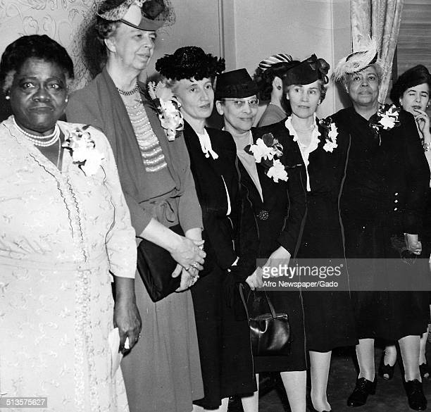 Educator and Civil Rights activist Mary McLeod Bethune students and former United States First Lady Eleanor Roosevelt standing at a conference...