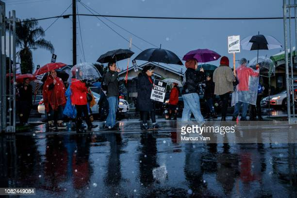 Educators and their supporters participate in the UTLA teacher's strike outside of Roosevelt High School as they walk off the job in their first...