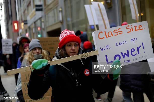 Educators from the Acero charter school network hold signs as they protest during a strike outside Chicago Public Schools headquarters on December 5...