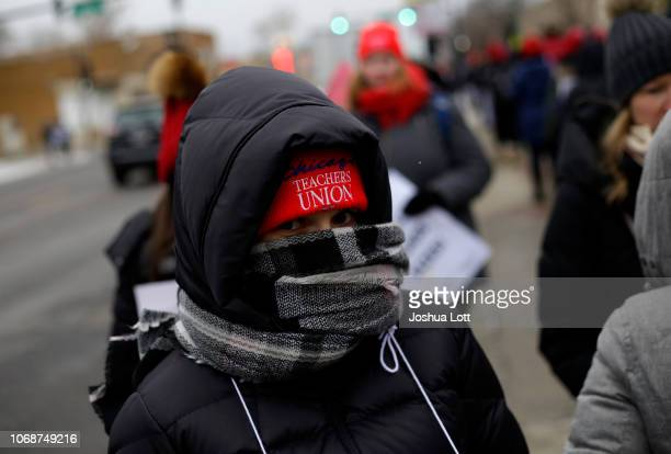 Educators from the Acero charter school network protest during a strike outside Zizumbo Elementary School on December 5 2018 in Chicago Illinois...