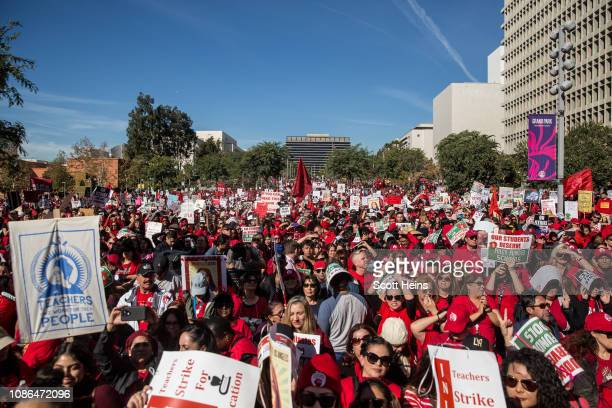 Educators, parents, students, and supporters of the Los Angeles teachers strike wave and cheer in Grand Park on January 22, 2019 in downtown Los...