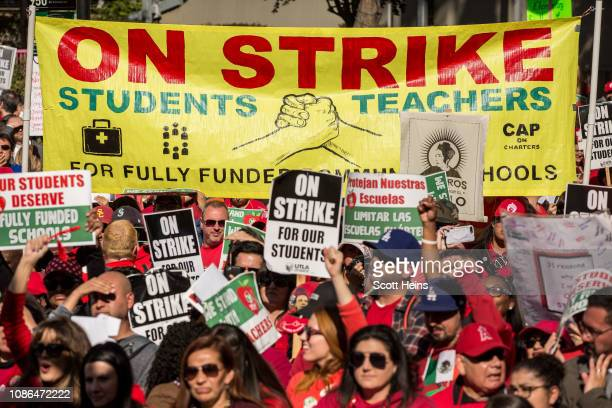 Educators parents students and supporters of the Los Angeles teachers strike wave and cheer in Grand Park on January 22 2019 in downtown Los Angeles...