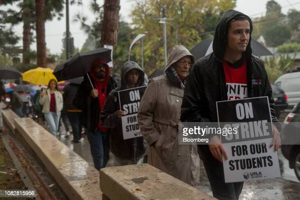 Educators, students, and supporters march a picket line during a teachers strike outside of John Marshall High School in Los Angeles, California,...