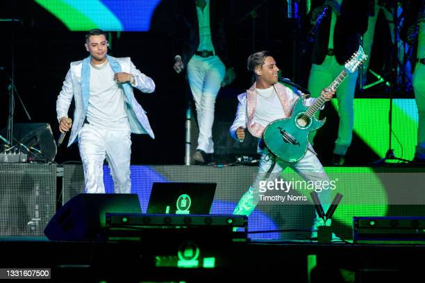 Eduin Caz and Joaquin Ruiz of Grupo Firme perform at Staples Center at Staples Center on July 30, 2021 in Los Angeles, California.