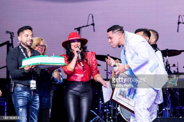 Eduin Caz of Grupo Firme is presented with a cake at Staples Center at Staples Center on July 30, 2021 in Los Angeles, California.