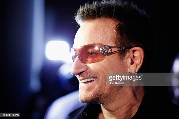 Edun cofounder Bono smiles backstage at the Edun Fall 2013 fashion show during MercedesBenz Fashion Week at Skylight West on February 7 2013 in New...