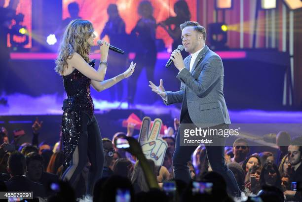 Edurne and Olly Murs perform during '40 Principales Awards' 2013 Gala at the Palacio de los Deportes on December 12 2013 in Madrid Spain