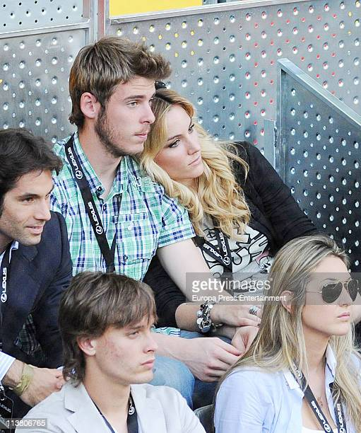 Edurne David Degea and Sergio Canales watch a tennis match during the Mutua Madrilena Madrid Open Tennis 2011 at La Caja Magica on May 5 2011 in...