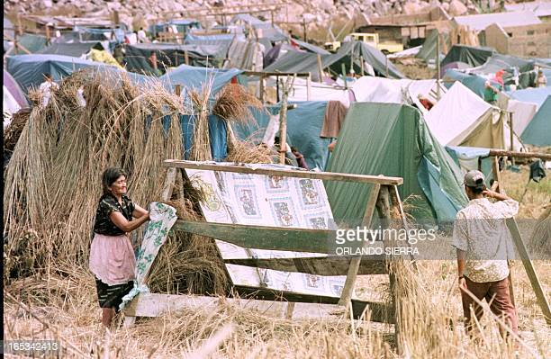 Eduvigues Matamoros a 67yearold victim of Hurricane Mitch builds a hut out of wooden planks and plastic sheeting 11 December on a vacant lot of land...