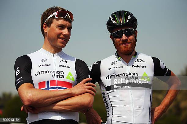 Edvald Boasson Hagen of Norway and Dimension Data chats to team mate Tyler Farrar of The USA at the start of stage one of the 2016 Tour of Qatar a...