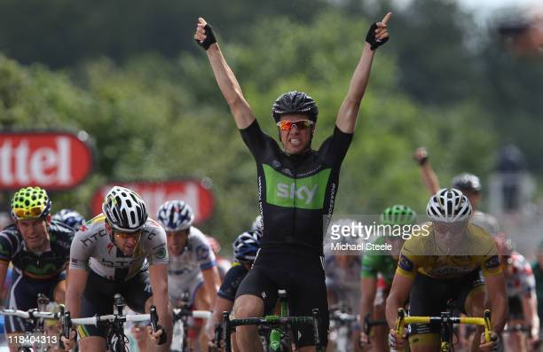 Edvald Boasson Hagen of Norway and the SKY Procycling team celebrates winning Stage 6 of the 2011 Tour de France from Dinan to Lisieux on July 7 2011...