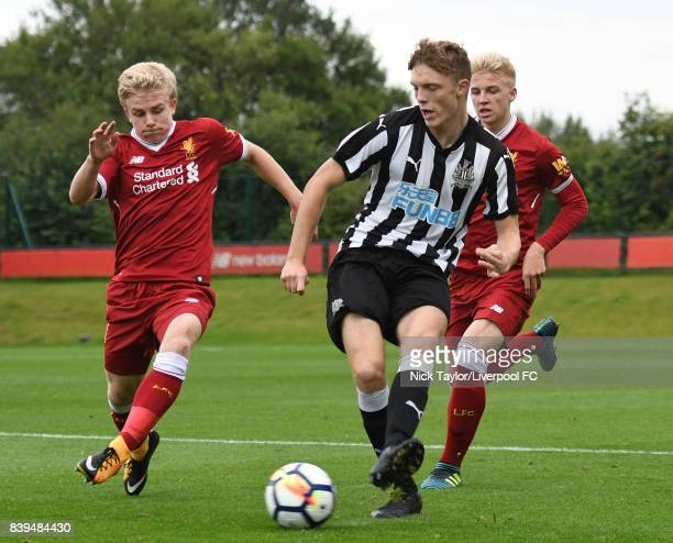 Edvard Sandvik Tagseth and Luis Longstaff of Liverpool and Kieren Aplin of Newcastle United in action during the Liverpool v Newcastle United U18...