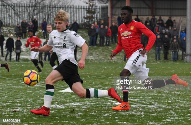 Edvard Tagseth of Liverpool and Aliou Traore of Manchester United in action during the Manchester United v Liverpool U18 Premier League game at The...