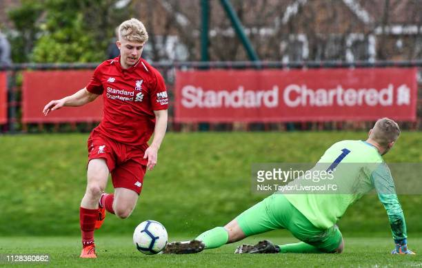 Edvard Tagseth of Liverpool rounds the keeper before scoring Liverpool's fifth goal during the U18 Premier League game at The Kirkby Academy on March...