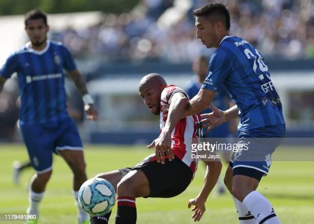 Edwar Lopez of Estudiantes de La Plata and German Guiffrey of Gimnasia y Esgrima fight for the ball during a match between Gimnasia y Esgrima La...
