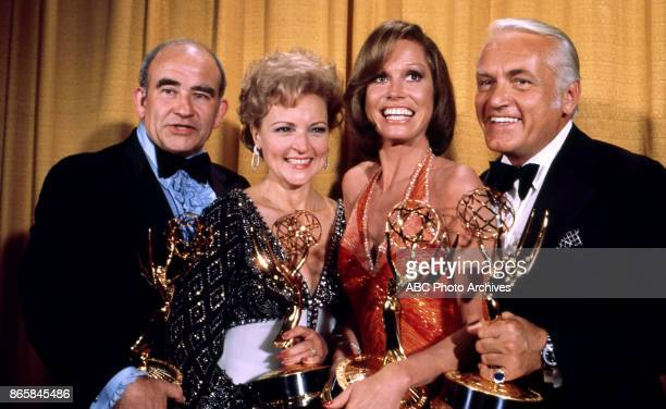 Edward Asner Betty White Mary Tyler Moore and Ted Knight holding their Emmy Awards in the press room at the 28th Annual Primetime Emmy Awards on May...