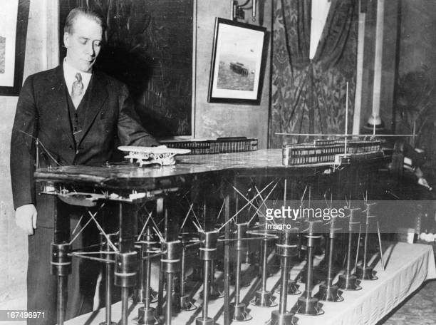 Edward B Armstrong in front of the model of a ocean air field which should be built in the Atlantic Ocean 250 km from New York away 9th April 1931...