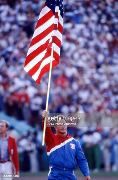 Edward Burke carrying US flag Opening ceremonies at the 1984 Summer Olympics Memorial Coliseum July 28 1984