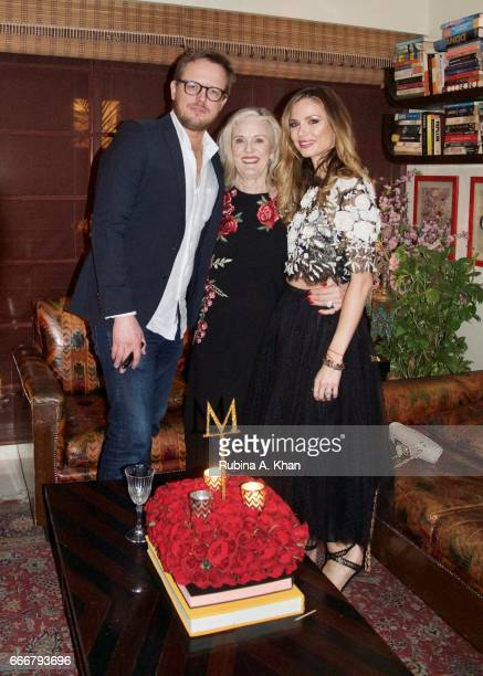 Edward Chapman Caroline Wonfor and Georgina Chapman cofounder and creative director of Marchesa fashion at a dinner party hosted by filmmaker Mozez...