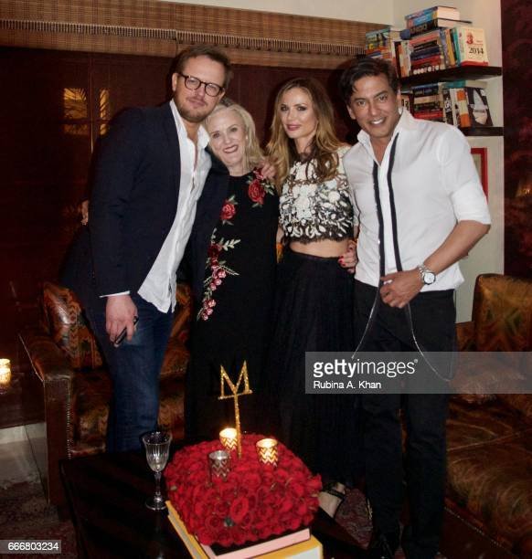 Edward Chapman Caroline Wonfor Georgina Chapman cofounder and creative director of Marchesa fashion and Parag Gupta at a dinner party hosted by...