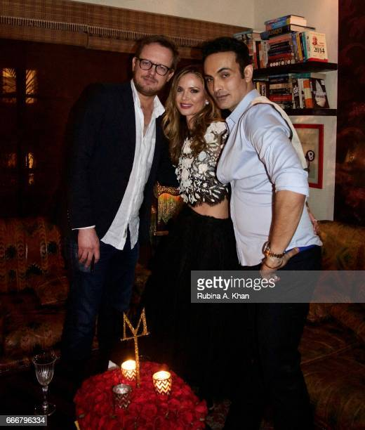 Edward Chapman Georgina Chapman cofounder and creative director of Marchesa fashion and filmmaker Mozez Singh at a dinner party hosted by him during...