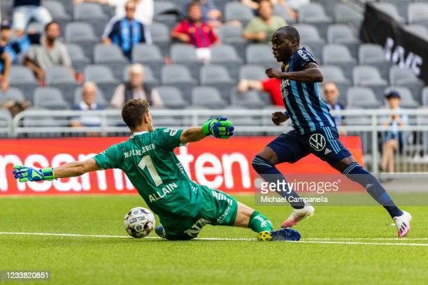 Edward Chilufya of Djurgardens IF is taken down in the penalty area by Orebro SK goalkeeper Bobby Allain during the Allsvenskan match between...