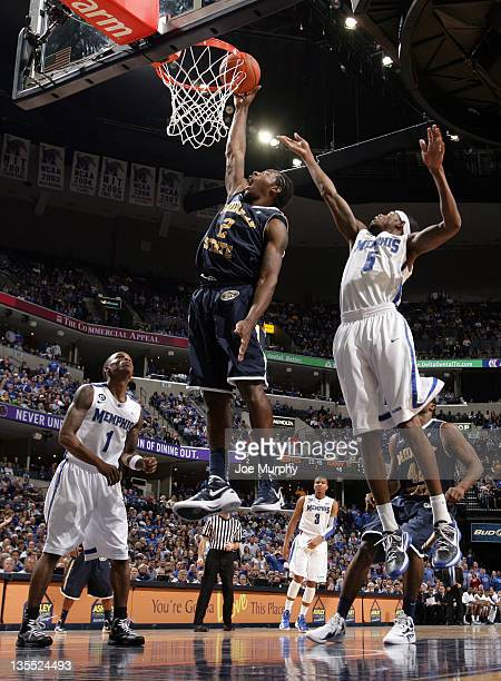 Edward Daniel of the Murray State Racers shoots a layup past Will Barton of the Memphis Tigers on December 11 2011 at FedExForum in Memphis Tennessee...