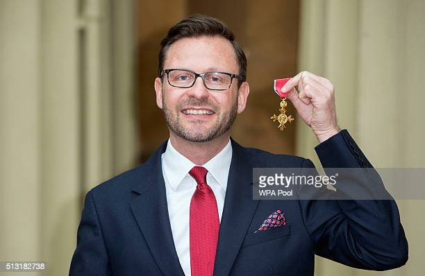 Edward Davis with his OBE presented to him by Queen Elizabeth II for services to the Ebola Crisis Response in West Africa following an investiture...