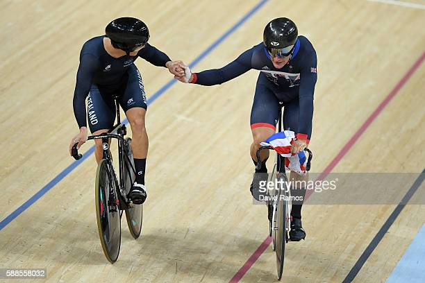 Edward Dawkins of New Zealand congratules Philip Hindes of Great Britain after Team GB wins gold and get an Olympic record in the Men's Team Sprint...