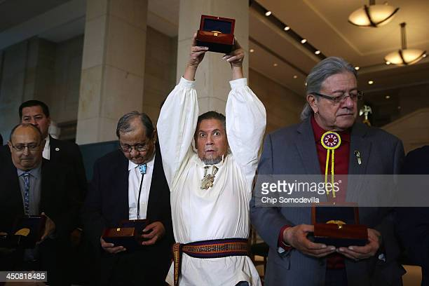 Edward Delgado of the Sovereign Oneida Nation of Wisconsin holds up one of the 33 Congressional Gold Medals presented to the Native American tribes...