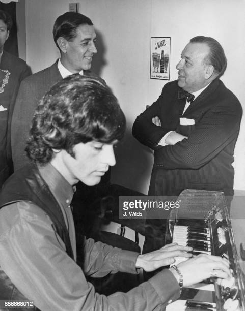 Edward du Cann the MP for Taunton and Conservative Party chairman watches musician Geoff Unwin on the Mellotron explained by bandleader Eric Robinson...