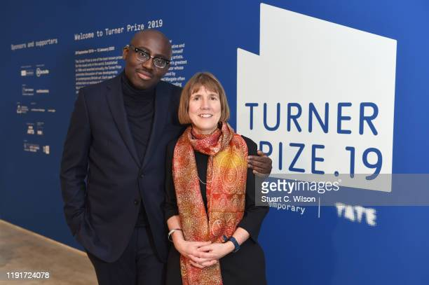 Edward Enniful Editor in Chief of British Vogue and Director of Turner Contemporary Victoria Pomery pose at the Evening Drinks Reception before the...