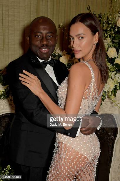 Edward Enninful and Irina Shayk attend the British Vogue and Tiffany Co Fashion and Film Party at Annabel's on February 2 2020 in London England