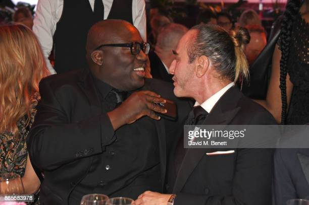 Edward Enninful and John Galliano attend a drinks reception ahead of The Fashion Awards 2017 in partnership with Swarovski at Royal Albert Hall on...