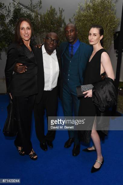 Edward Enninful Ozwald Boateng and Erin O'Connor attend a dinner hosted by Jonathan Newhouse and Albert Read for Edward Enninful to celebrate the...