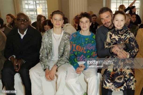 Edward Enninful, Romeo Beckham, Cruz Beckham, David Beckham and Harper Beckham attend the Victoria Beckham show during London Fashion Week February...