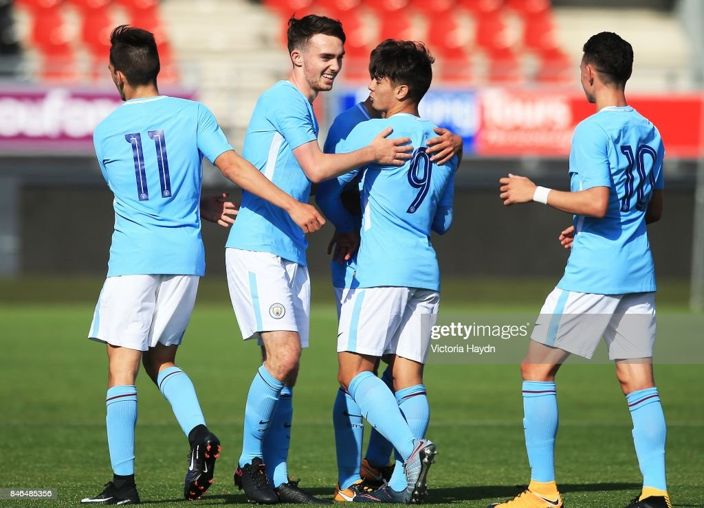 Edward Francis (2nd L) and Brahim Diaz (2nd R) of Manchester City celebrate the second goal of the match during the UEFA Youth Champions League group F match between Feyenoord and Manchester City on September 13, 2017 in Rotterdam, Netherlands.