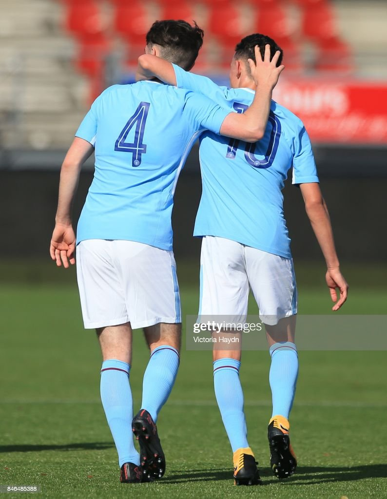 Edward Francis and Phil Foden of Manchester City celebrate the second goal of the match during the UEFA Youth Champions League group F match between Feyenoord and Manchester City on September 13, 2017 in Rotterdam, Netherlands.