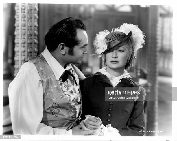 Edward G Robinson as 'Luis Chamalis' and Miriam Hopkins as 'Mary Swan Rutledge' in a publicity shot from the movie 'Barbary Coast' United States