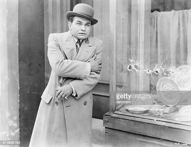 Edward G Robinson clutching his arm after a gun fight Scene from Little Caesar