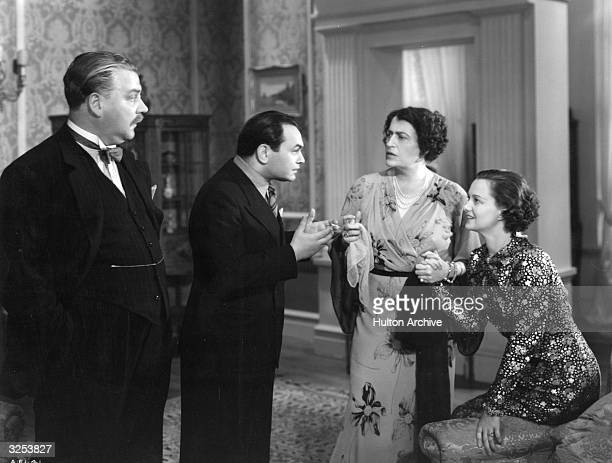 Edward G Robinson Nigel Bruce Constance Collier and Luli Deste in 'Thunder In The City' a satire on British and American idiosyncrasies directed by...