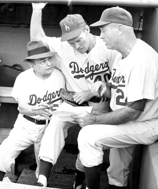 Edward G. Robinson, wearing a Dodgers uniform, Chuck Connors
