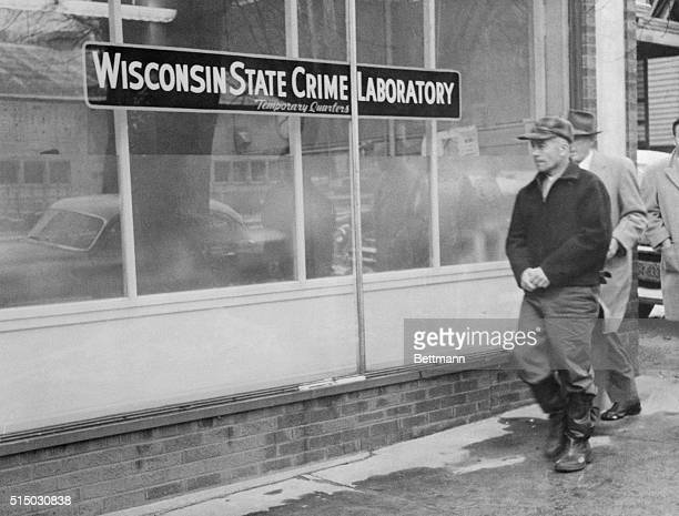 Edward Gein owner of Plainfield Wisconsin farm where butchered body of Mrs Bernice Worden was discovered hanging in a shed is shown as he was taken...
