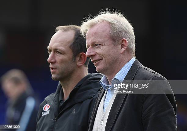 Edward Grifffiths the Saracens chief executive looks on with director of rugby Brendan Venter during the Aviva Premiership match between Sale Sharks...