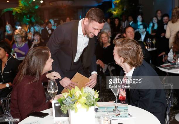 Edward Holcroft greets Thomas BrodieSangster at the Newport Beach Film Festival UK Honours in association with Visit Newport Beach at The Rosewood...