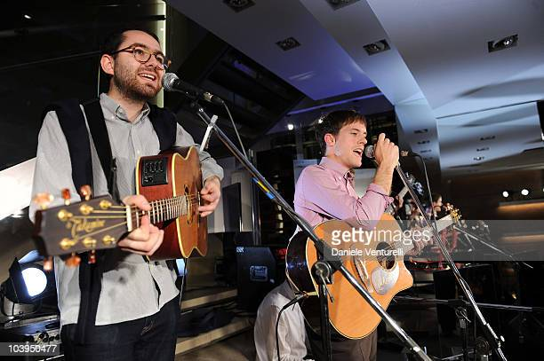 Edward Ibbotson and Sam Fry of the band Life In Film perform during the VOGUE Fashion's Night Out at the Burberry boutique on September 09, 2010 in...