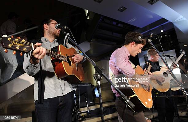 Edward Ibbotson, Sam Fry and Dominic Sennet of the band Life In Film perform during the VOGUE Fashion's Night Out at the Burberry boutique on...
