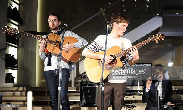 Edward Ibbotson, Sam Fry and Micky Osment of the band Life In Film perform during the VOGUE Fashion's Night Out at the Burberry boutique on September...